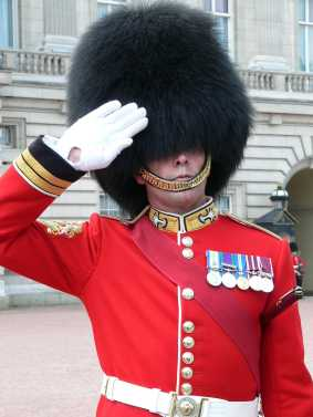 Chin straps worn over the face in military dress parades - why
