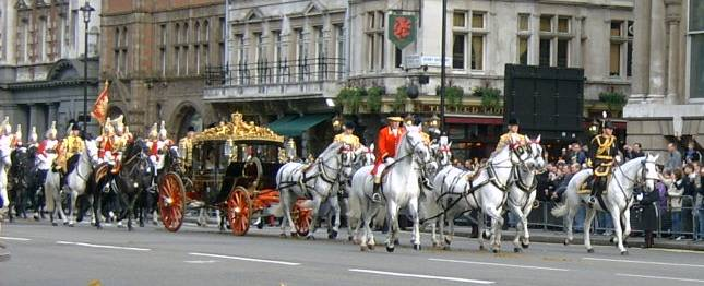 The Irish  State Coach passes in procession along Whitehall towards The Houses of Parliament